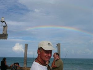A rainbow behind me at the Cocoa Beach Pier. Hurricane Danielle waves below.