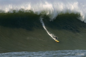 "Shawn Dollar won the 2010 Billabong XXL Monster Paddle in, on a ""Record paddle in anywhere"" 55 foot face paddle in at Mavericks.  Phil Gibbs , photographer"