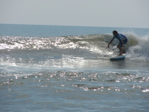Dave, (Sunny's dad),  getting ready to setup for a nice right, while surfing a glassy sesh in South Cocoa Beach, May 14, 2011.