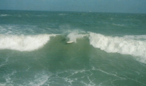 A picture I took with an exhumed 35 mm camera with not prior practice, just to get some pitiful shots of a huge Halloween 2007 swell that we had.  This was a 12 foot plus face wave that I shot from the back of Cocoa Beach pier.  It was about a 2 1/2 board stacked end to end face so the guy had a pretty good fall.