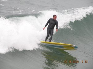 My buddy Rob surfing Newport Beach, Ca. pier on a nice left in July of 2009