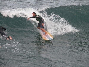 My buddy Rob from Newport Beach surfing his home break.  This is a summer September 2009 pic.
