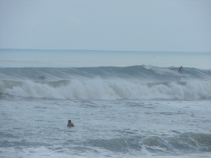 Image 2 of 6 sequence.  The same guy on a killer long left at O' Club.  Hurricane Katia, Thursday, September 8 2011, photos by oldwaverider
