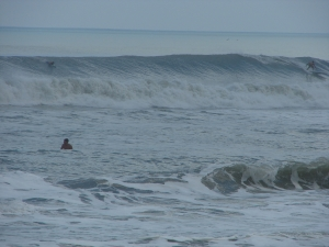 Image 3 of 6 shot sequence.  Longboarder on a sweet long left.  Hurricane Katia, Thursday, September 8 2011, photos by oldwaverider
