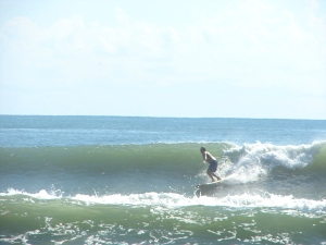Image 1 of 5, MIke on a shoulder high right at 4rth street, Tropical Storm Maria, Thursday September 15, 2011, taken by yours truly :)