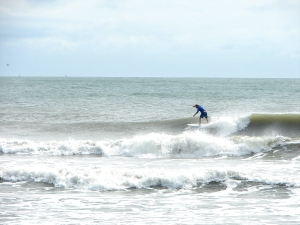 Dave taking advantage of an overcast, drizzly, windy day at the Cape.  Image 1 of 4 in sequence.  Photo by oldwaverider