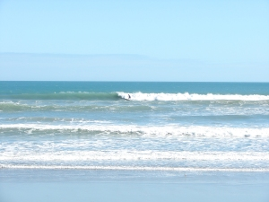Image 5 of 7, MIke on a long right shoulder/head high high wave.