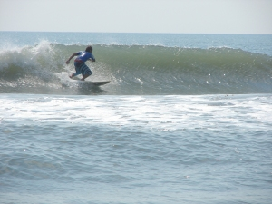 Sunny making his relentless barrel pursuit on a waist high gem. Image 1 of 3 sequence. Photos by Chad.