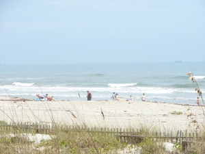 A nice day, some Sun, a little haze,  some fun waves, people just enjoying the beach :)