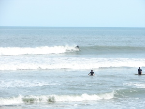 Pulls out of a slight barrell and another attempt to drop low and pull out in front. Image 6 of 7 sequence.
