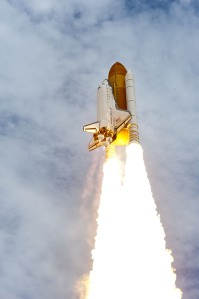 Direct from NASA's website, content and the Image above: Riding a plume of fire, space shuttle Atlantis heads into the cloud-laden sky over Launch Pad 39A at NASA's Kennedy Space Center in Florida. Image credit: NASA/Tony Gray and Tom Farrar