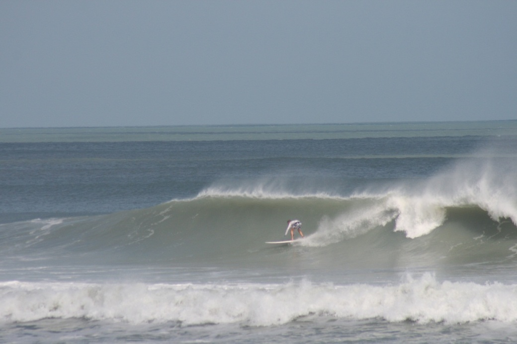 Oldwaverider (Art Hansen), enjoying an epic right at Satellite Beach, Sunday October 28 2012, Image 3 of 4 sequence.