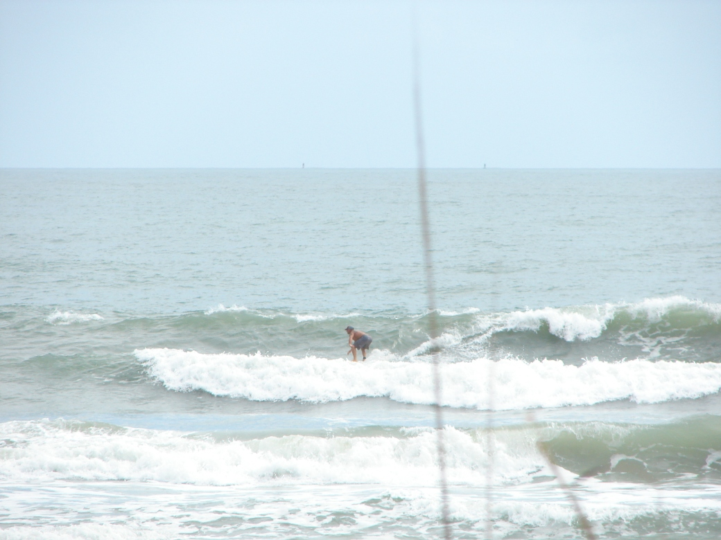 Image 2 of 4 sequence, Chuck, on of many nice rides today, Monday , October 15 2012, the day before Hurricane Rafael sends us waves. Photos by Oldwaverider, Art Hansen